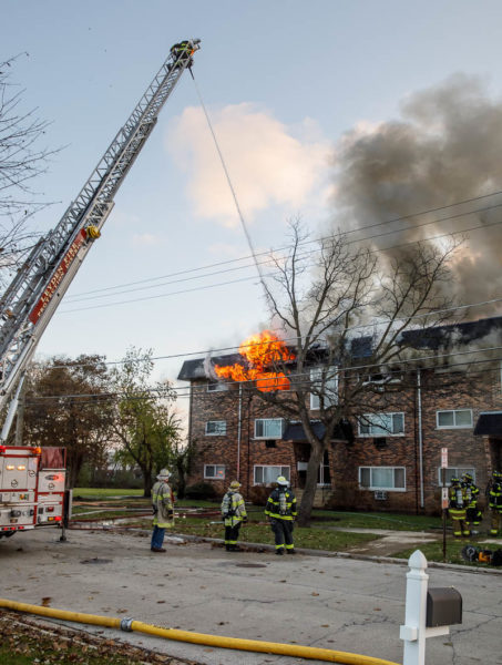 flames shoot from apartment building