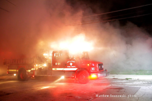 Flint fire engine at night engulfed in smoke