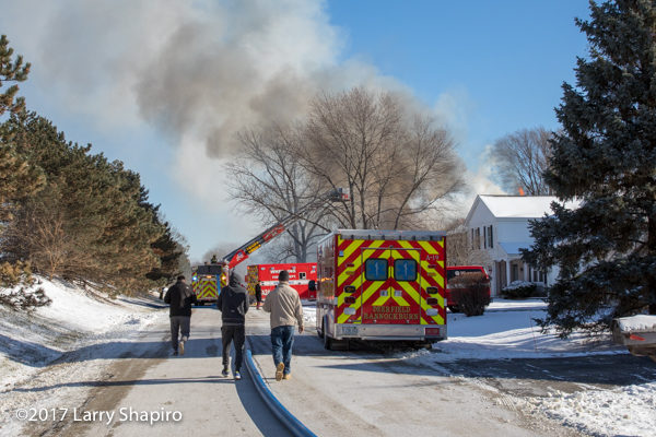 fire apparatus in street during house fire