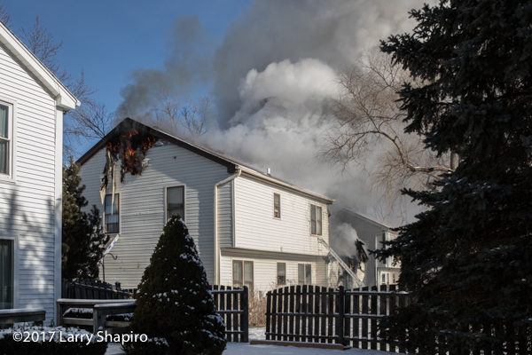smoke and flames from house on fire in the winter