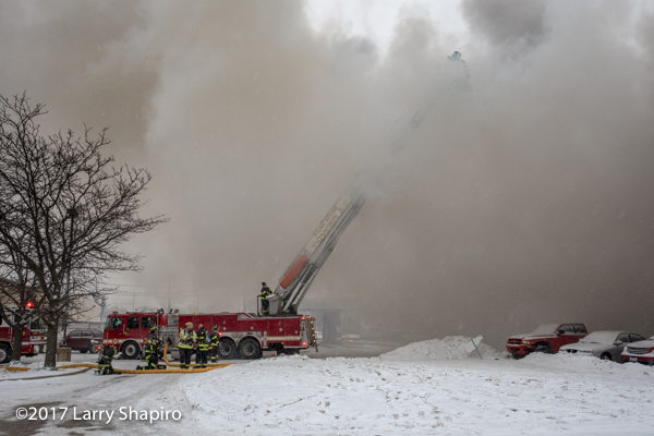 E-ONE tower ladder immersed in smoke