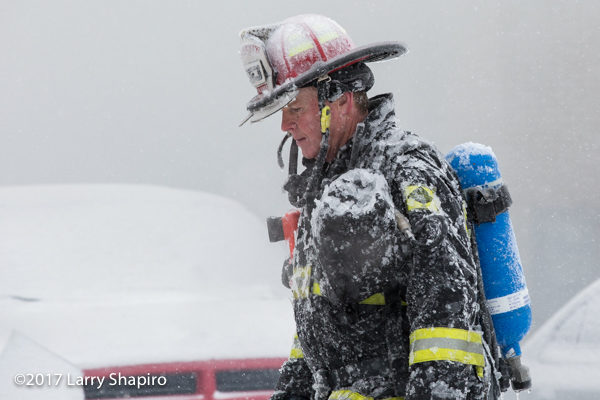 firefighter coated with ice