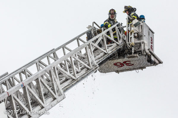 tower ladder coated with ice