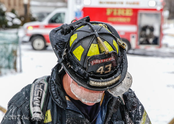 firefighter with ice on helmet