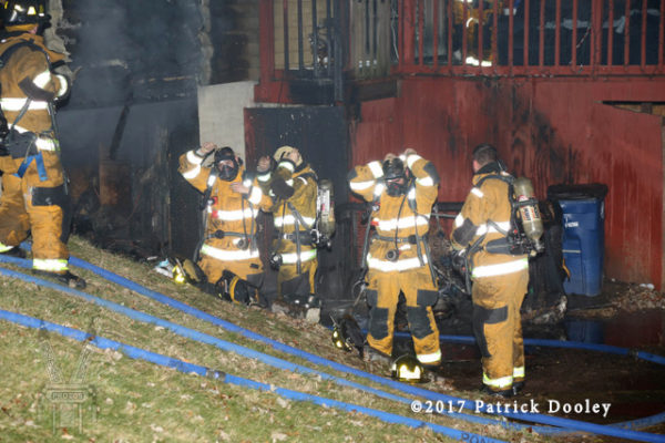 firefighters mask up at fire scene