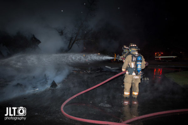 garage destroyed by fire at night