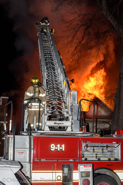 Seagrave aerial ladder at night house fire