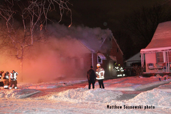 winter house fire at night