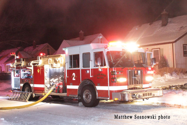 Sutphen fire engine at a night fire scene