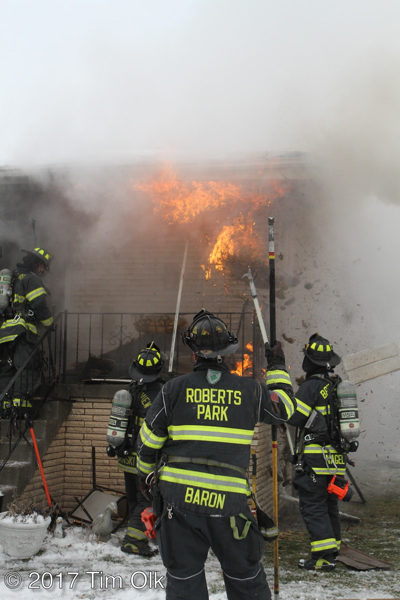 firefighters pull soffit with flames