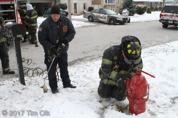 firefighters thaw frozen hydrant