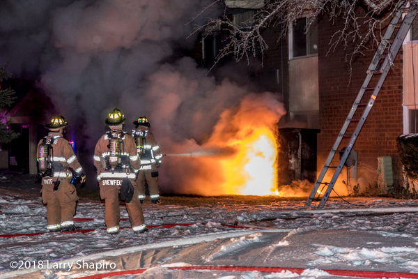 firefighters attempt to extinguish huge flames that engulf electric control box