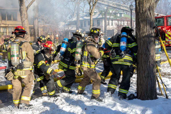 firefighters work together to move LDH