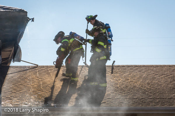 firefighters vent roof with a saw