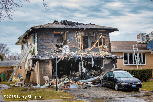 aftermath of house fire from attached garage