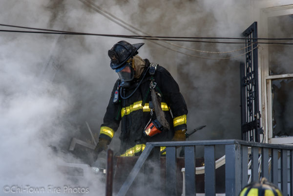 Firefighter in PPE surrounded by smoke