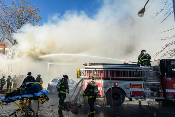 Chicago firefighters battle fire in a house