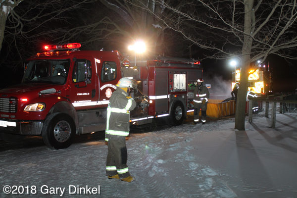 fire truck on scene at night in Canada
