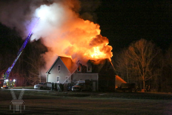 heavy flames and smoke from house fire at night