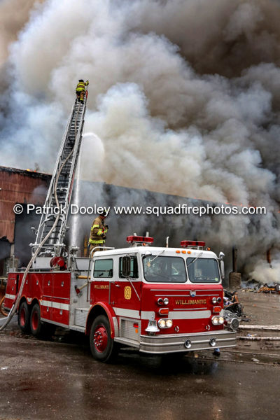 Willimantic FD Maxim aerial ladder at work