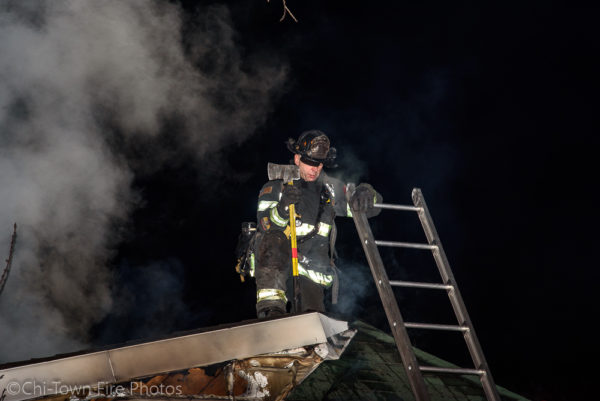 Firefighter on the roof at night