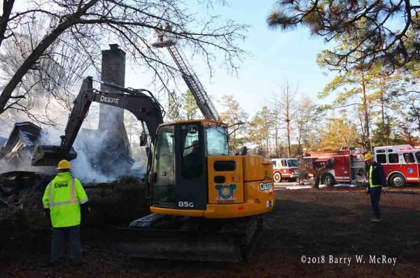 excavator works after house fire