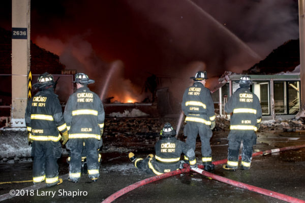 Chicago Firefighters with master stream at fire scene