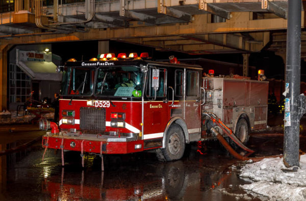 spare Chicago FD fire engine at fire scene
