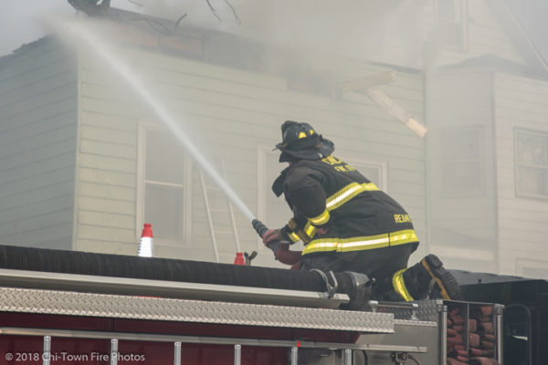 Firefighter deploys deck gun from engine