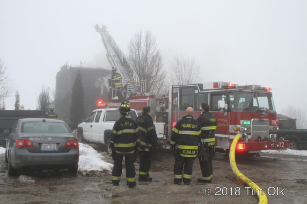 Firefighters at winter fire scene