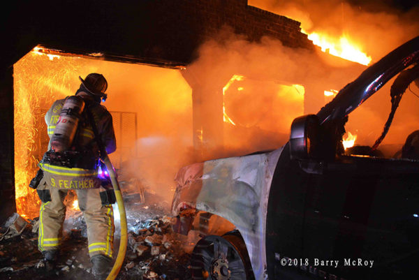 Firefighter battles house fire at night