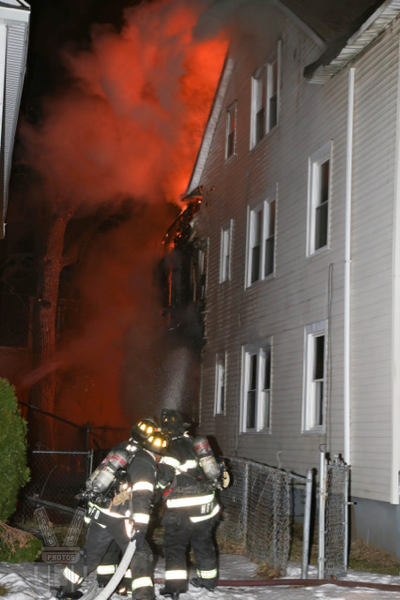 Firefighters battle building fire at night