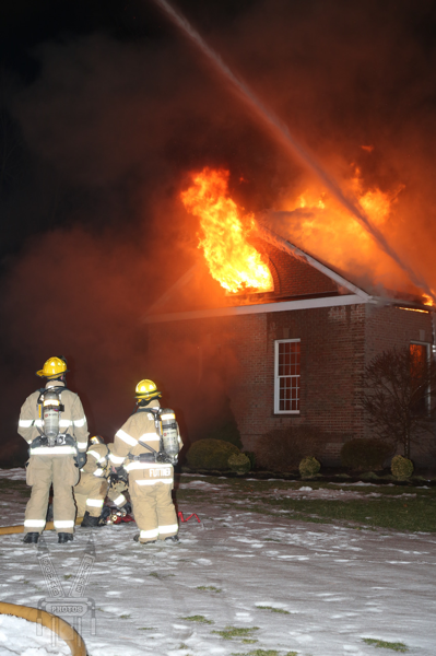 Firefighters at house fire with big flames