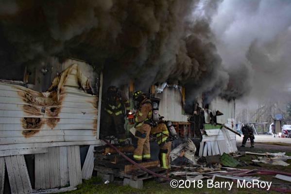 heavy smoke from mobile home on fire