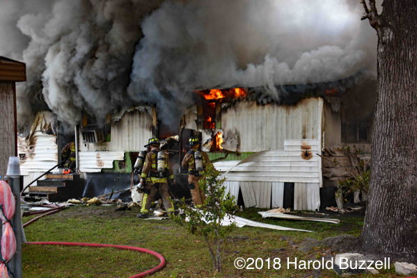 Firefighters overhaul mobile home fire