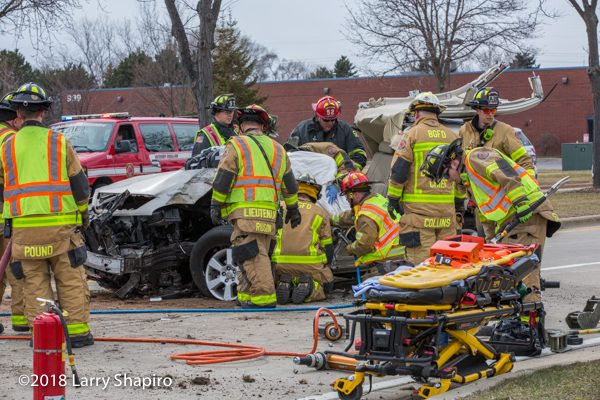 Firefighters free driver trapped in car Stryker power load cot