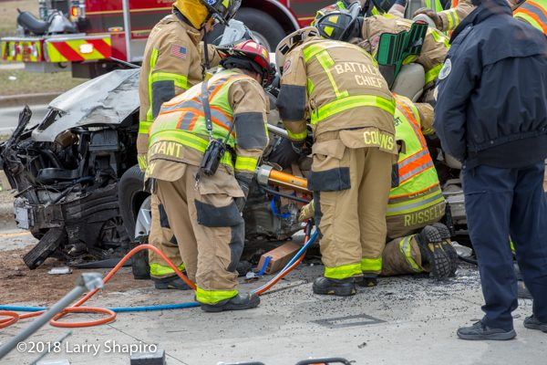 Firefighters use Holmatro rescue spreaders at crash