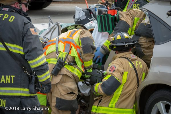 Firefighters use Holmatro battery spreader at crash