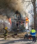 vacant house engulfed in flames