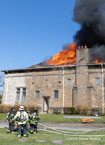 fire engulfs roof of a chapel