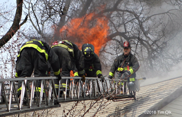 Firefighters climb aerial ladder