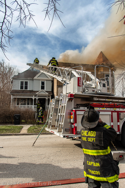Chicago Firefighters at house fire with ladder truck