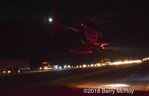 C.A.R.E Medical helicopter landing on the highway
