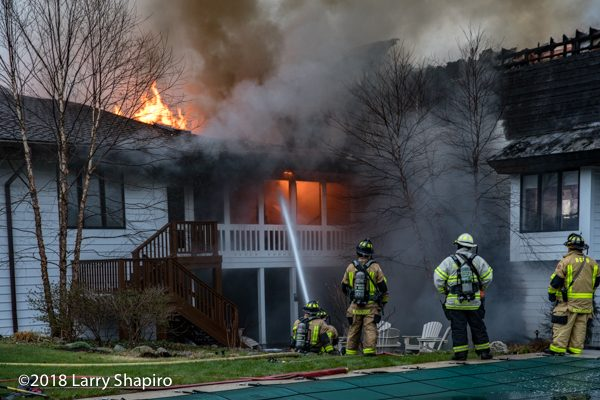 Firefighters battle huge house fire
