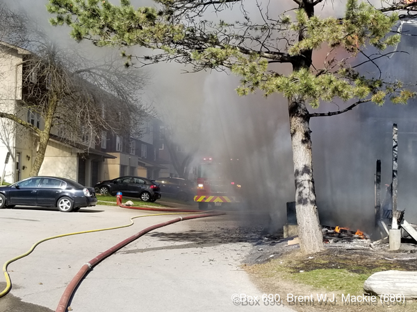 Firefighters battle townhouse fire