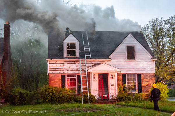 Firefighters vents roof during house fire with lots of smoke