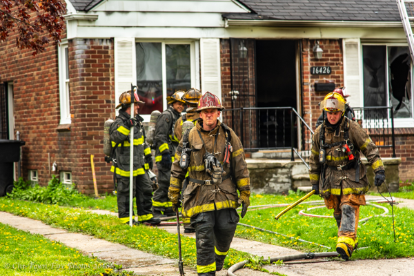 Detroit Firefighters after battling a dwelling fire