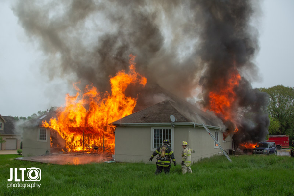 flames consume house