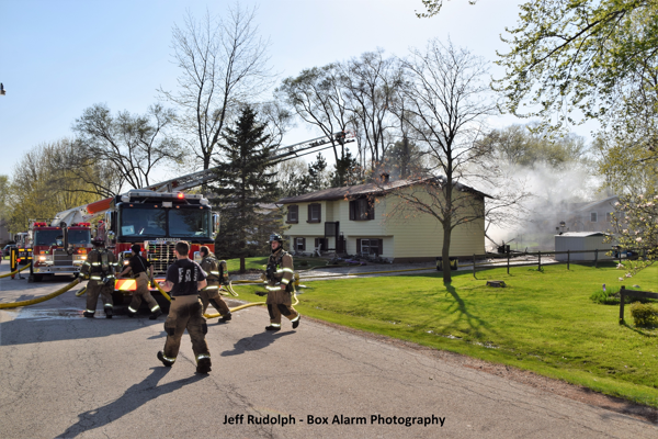 fire scene with trucks and Firefighters