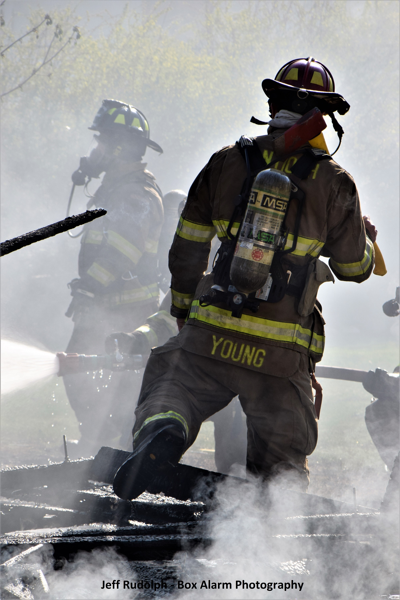 Firefighter in smoke after house fire
